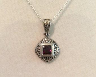 DBJ Garnet Sterling Silver Ornate Pendant, 2g.