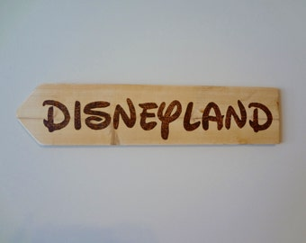 "Wood burned by Hand Road Sign: ""Disneyland"""