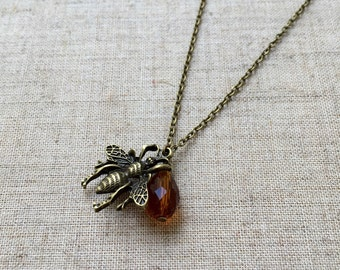 Bronze honeybee and glass bead pendant necklace.