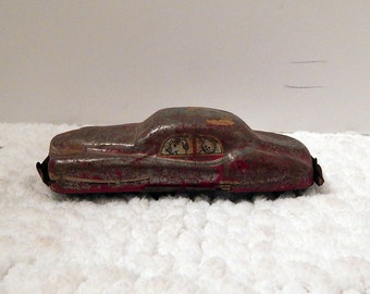 distressed tin toy car