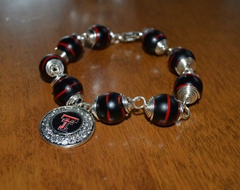 Red and Black swirl bead coil wrapped bracelet with Texas Tech charm