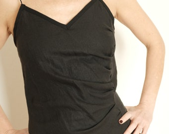 top in black linen with small drapery on the left , size S