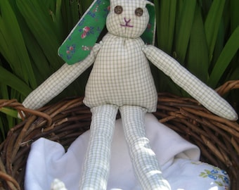 Soft toy bunny in green.