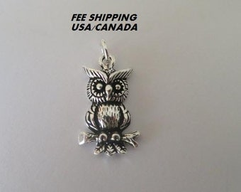 Owl pendant set in 92.5 sterling silver