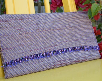 Clutch handwoven out of plastic shopping bags, hand beaded detail