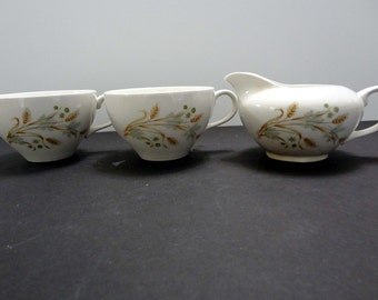Vintage cups with Creamer