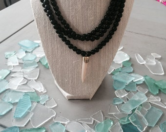 Long Black Bead Necklace With Cream Tooth