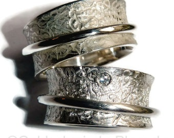Rolling rings made of silver with brilliant, as a special wedding rings to wear - silver weddingrings with diamond