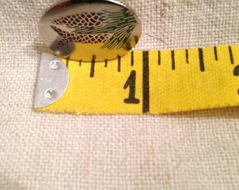 Unique pine cone tie tack
