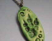 Super SALE! Pendant Necklace, Dragon/Dinosaur Tracks, Polymer Clay
