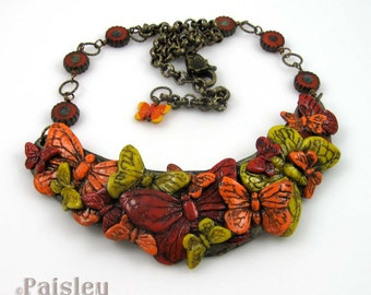 Red Orange Yellow  Butterfly Bib Necklace, polymer clay collage and glass beads on antique finish brass chain, adjustable length