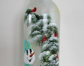 Snowman Standing Next to a Whimiscal Winter Tree and Feeding Cardinals