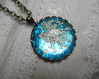 Icy Colorado Winter-Queen Anne's Lace Bronze Crown Pendant Atop Hologram Turquoise Snowflake Background-Gifts Under 30-Symbol of Peace