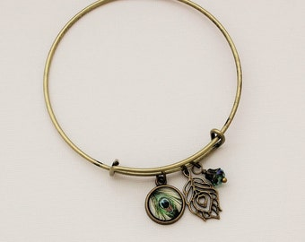 Peacock Bangle Charm Bracelet in Antique Brass