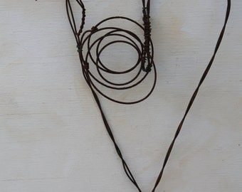 handmade wall heart made of baling wire and rusted chair spring