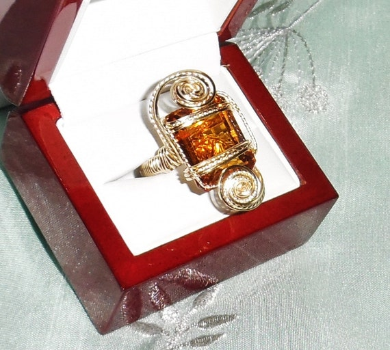 19 ct Natural Emerald cut Orange Citrine gemstone, 14kt yellow gold Ring Size 7