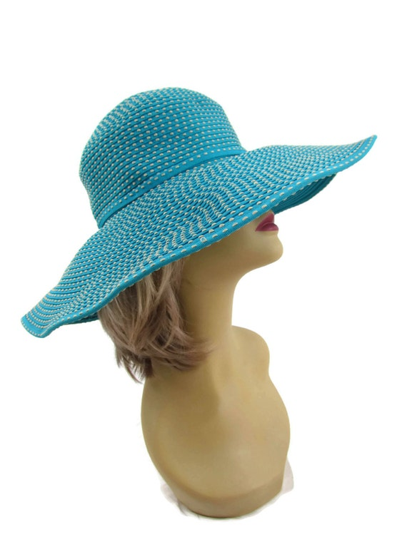 This super cute floppy big white hat is perfect for anyone vacationing or spending a day in the sun. It is new and has the tags and also is one size fits all. It has a gold band for extra detail and i Summer Derby Big Super Wide Brim 8