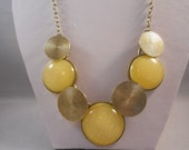 Bib Necklace with Gold Tone and Yellow Pendants on a Gold Tone Chain