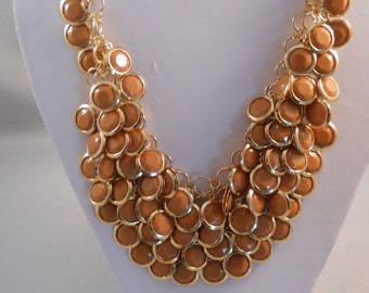 4 Row Bib Necklace Gold Tone and Brown Pendants on a Gold Tone Chain