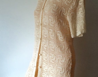 Vintage hand Crocheted pinwheel patterned button down sweater.