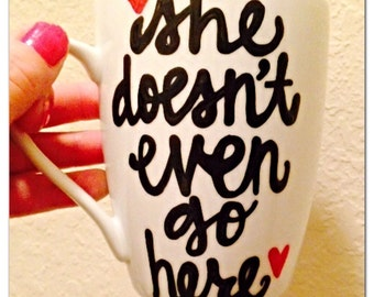 She doesnt even go here  Gretchen wieners mean girls hilarious mug. Mean girls coffee cup. You go glen co co