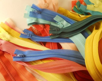 ZIPPERS:  SET of 63 ZIPPERS, 14 inch closed end, beulon, mixed colors.