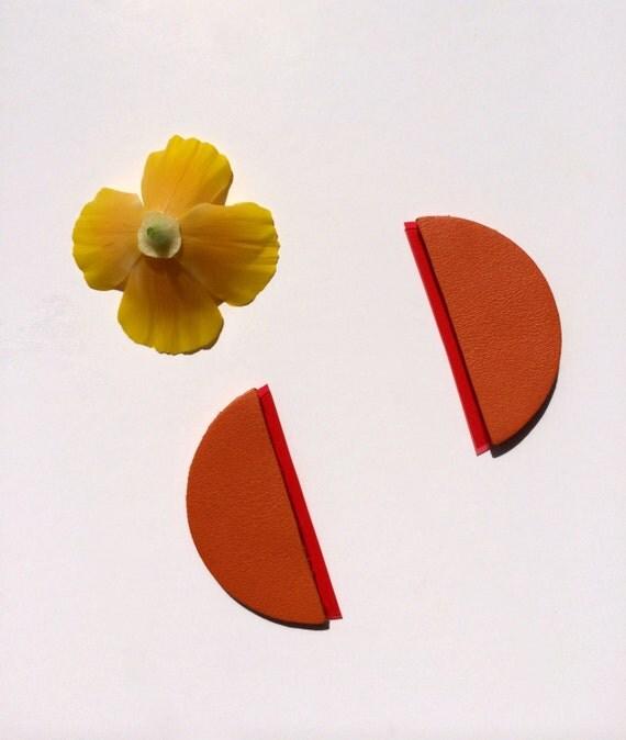 Orange geometric leather and vinyl earrings