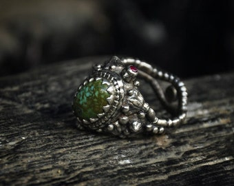 Ring with turquoise and rubies, with secret box.