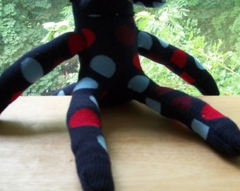 Navy blue polka-dot sock monkey