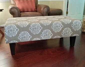 upholstered ottoman coffee table tan and cream by theedenshouse. Black Bedroom Furniture Sets. Home Design Ideas