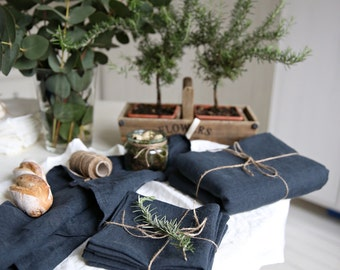 The set of tablecloth, 4 napkins and 2 tea towels in washed soft linen