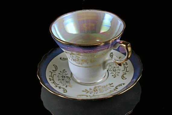Teacup and Saucer Opalescent Iridescent Footed National Potteries Co.