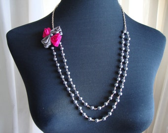 Beautiful pearl necklace and satin flower. Beautiful necklace of pearls and satin flowers