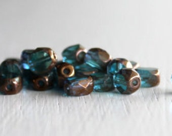 25 Blue Zircon/Bronze Window Cut 5x6mm Beveled Ovals - Czech Glass Beads