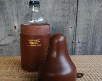 antique French cologne bottle with leather travel case
