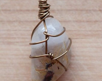 Wire wrapped rutilated/tourmalinated quartz.