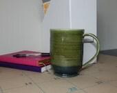 Avocado green mug with dark band detail