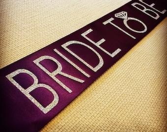 "Purple ""Bride To Be"" sash"