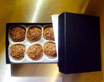 Six chocolate truffles (champagne or rum)