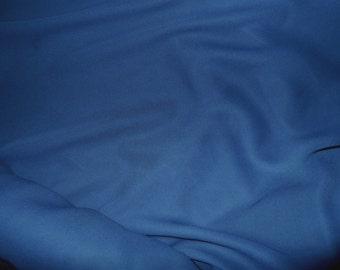Deep Ocean Blue Sheer Georgette Fabric, a dark dusty blue shading