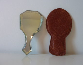 Small old beveled hand mirror