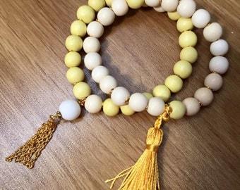 Duo of beads a Pompom ornate wooden bracelets