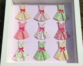 Box frame with mini origami dress.