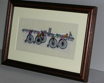 A new embroidered Stevengraph type picture - Penny Farthing bicycle race .