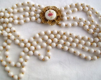 Vintage Four Strand White Bead Necklace with Feature Porcelain Flower Cabochon Fastening