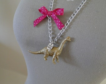 Necklace gold and pink dinosaur