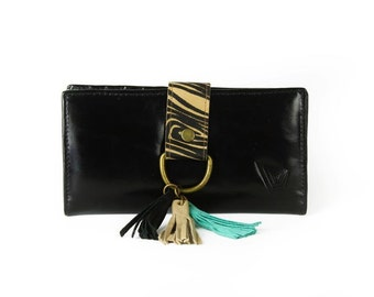 Wallet. Black Ladys wallet in leather, fringes decoration. Free shipping on purchases over 100 usd.