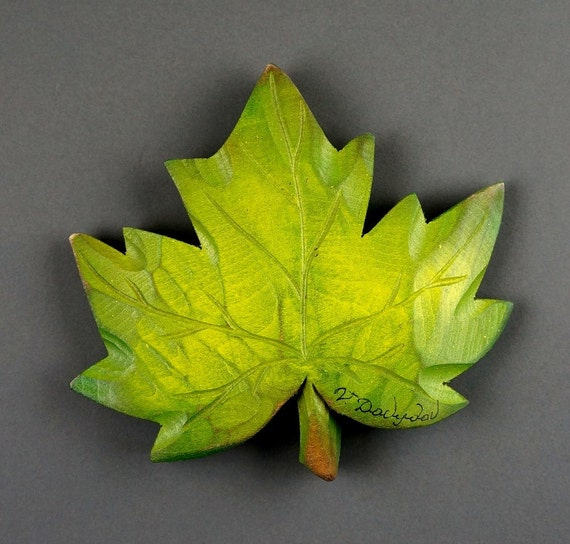 Carved wooden maple leaf green