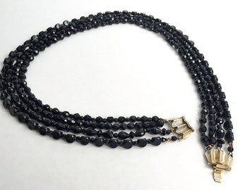 Four strand faceted black glass bead necklace