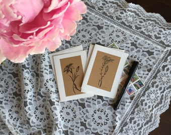 Set of two hand-drawn, printed notecards.